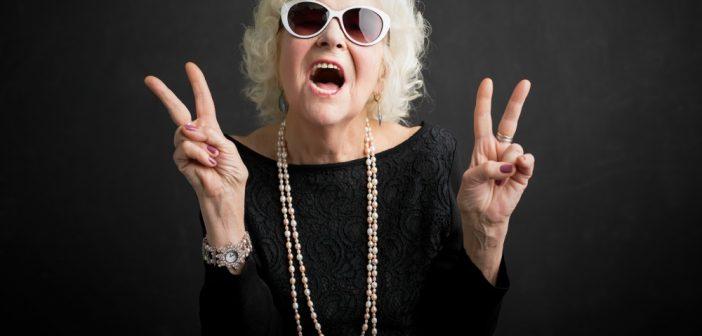 Grandma wearing sunglass with peace sign