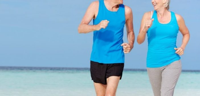 couple running at the beach