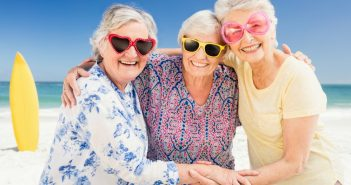 Ladies wearing sunglasses at the beach
