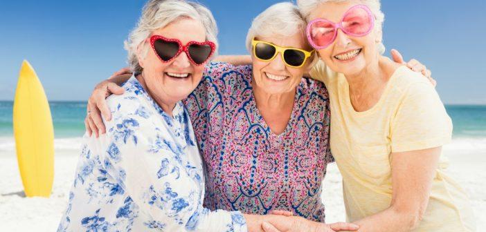 Ladies wearing sunglasses at the beach