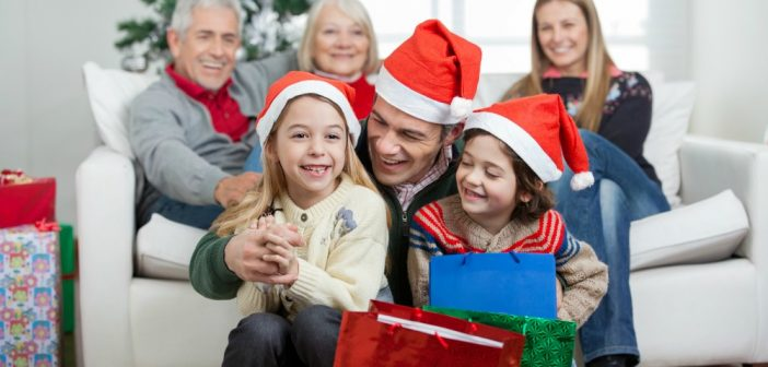 Family celebrating Christmas with gifts