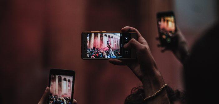 Hands holding cameras