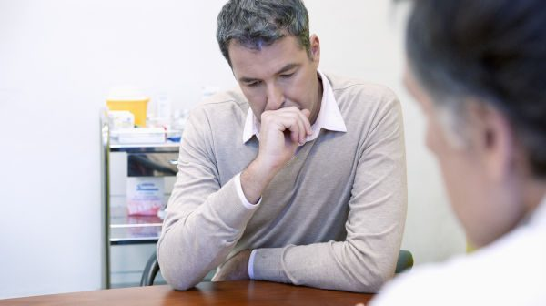 Man talking to a doctor