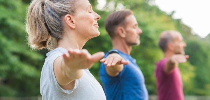 Adult Men and Woman having yoga
