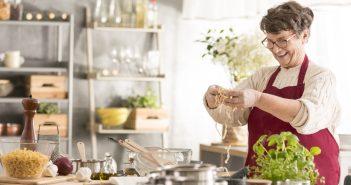 Senior woman having fun on cooking