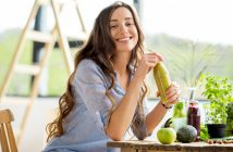 Beautiful happy woman sitting with healthy drinks