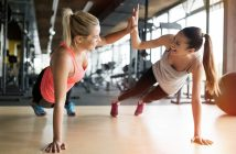 Two girls working out together at gym