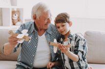 Senior man playing with his grandson